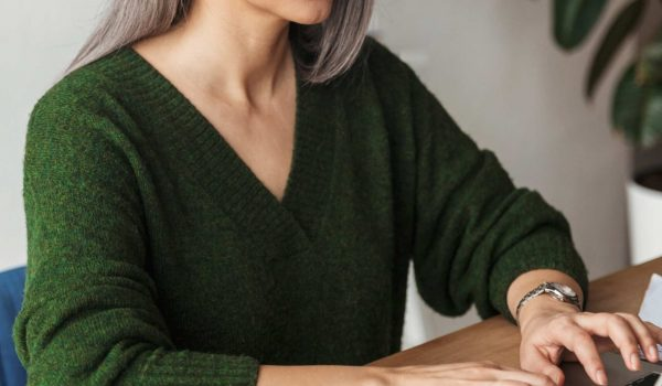 photo-of-gray-haired-focused-businesswoman-typing-MJKPXEZ-scaled.jpg